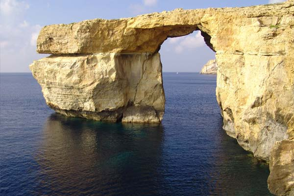 Touristic attractions of Malta : Fungus Rock and Dwerja Bay, Gozo